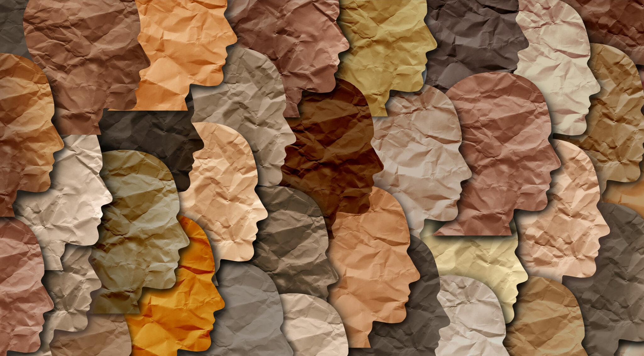 Collage aus Scherenschnitten von Gesichtern in verschiedenen Farben.