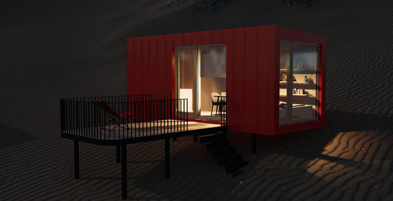 Beleuchtetes Tiny House am nächtlichen Strand.