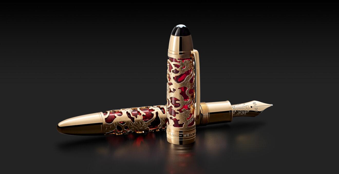 Edler Montblanc-Füller in Gold und Rot mit Verzierungen im chinesischen Stil.