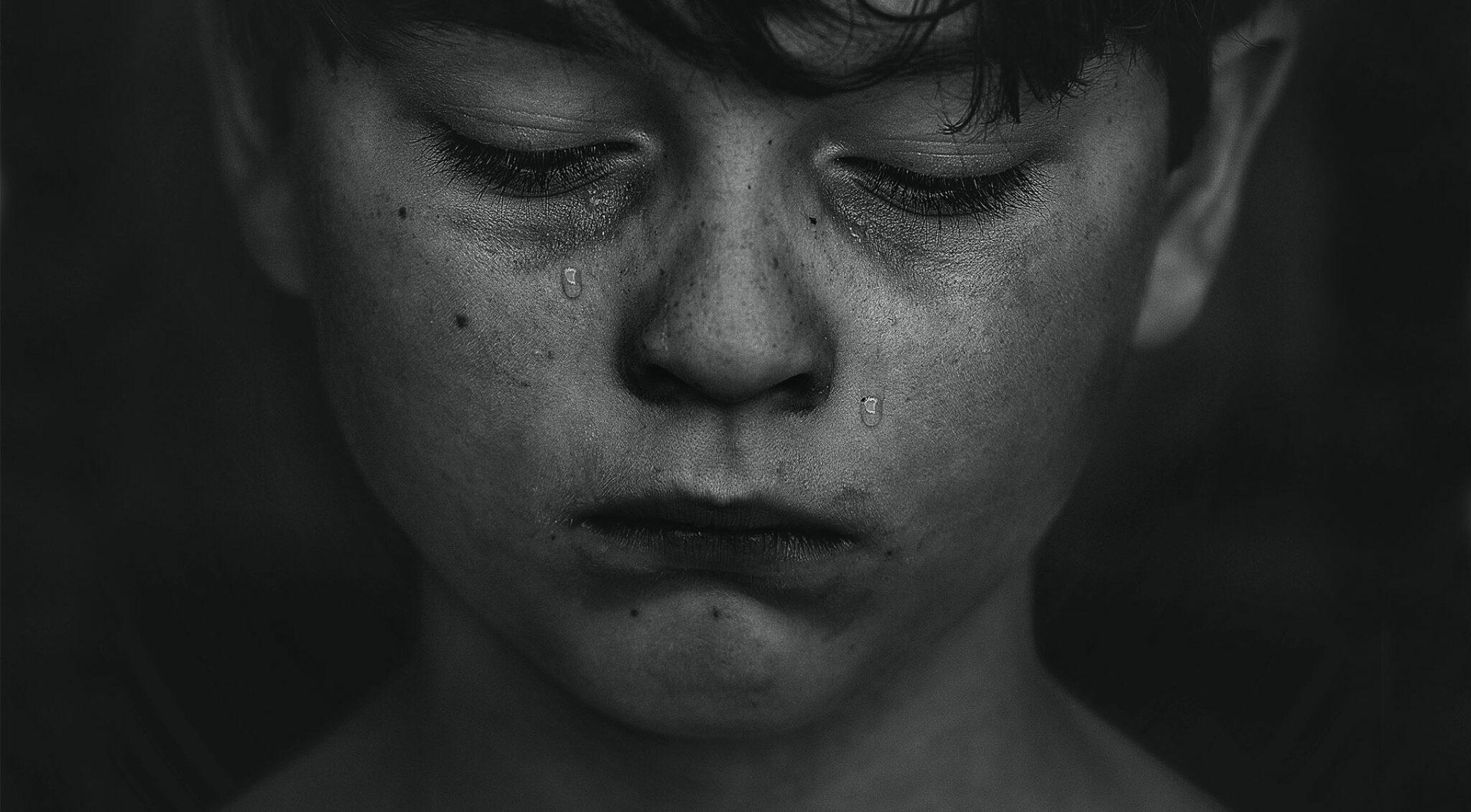 Gesicht eines Kindes mit geschlossenen Augen